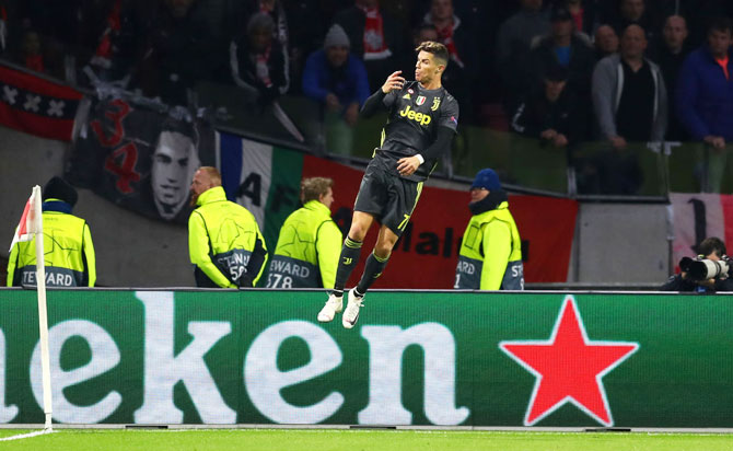 Juventus' Cristiano Ronaldo celebrates after scoring his team's first goal during their match against Ajax at Johan Cruyff Arena in Amsterdam