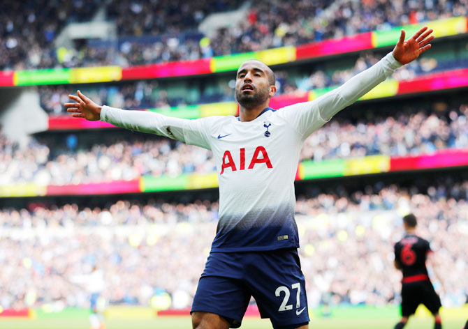Lucas Moura celebrates scoring Tottenham's fourth goal to complete a hat-trick against Huddersfield at Tottenham Hotspur Stadium in London on Saturday