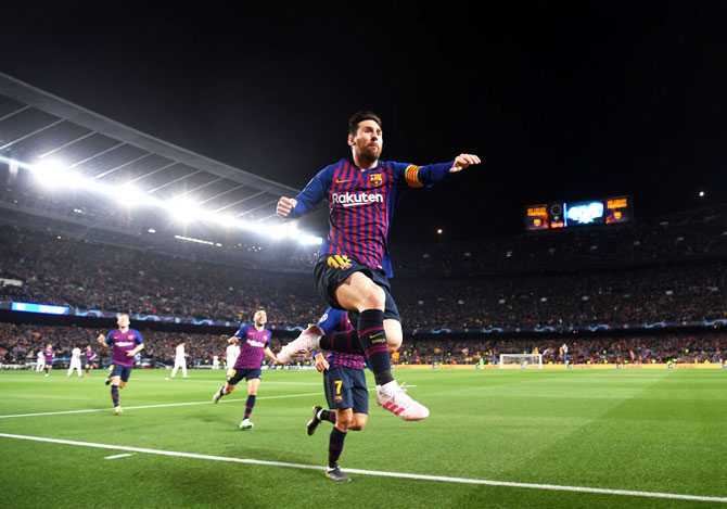 FC Barcelona'S Lionel Messi celebrates after scoring the first goal against Manchester United at Camp Nou in Barcelona