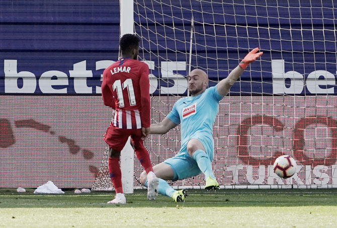 Atletico Madrid's Thomas Lemar scores against Eibar in their La Liga match at Ipurua, Eibar, on Saturday