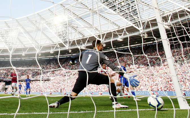 Leicester City's Jamie Vardy scores their first goal against West Ham United at London Stadium, London