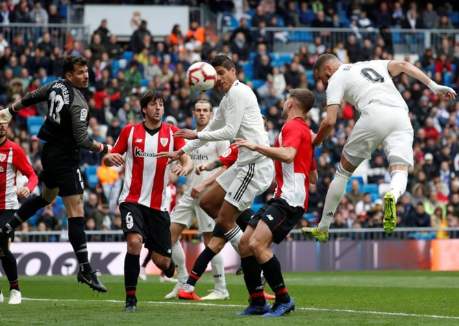 Real Madrid's Karim Benzema scores their second goal Athletic Bilbao during their La Liga match on Sunday