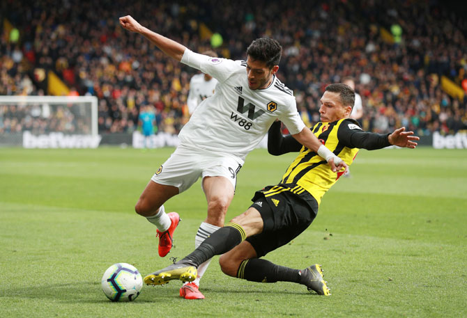 Wolverhampton Wanderers' Raul Jimenez in action with Watford's Jose Holebas during their match at Vicarage Road, Watford