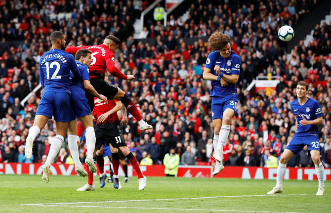 Manchester United's Marcos Rojo heads at goal past Chelsea's David Luiz