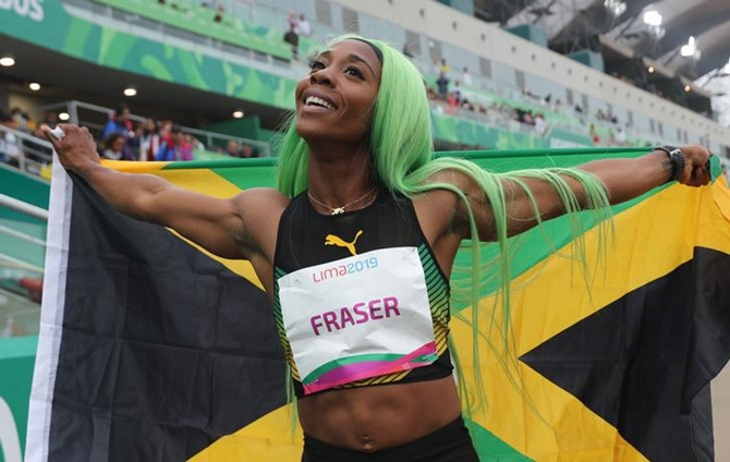 Jamaica's Shelly-Ann Fraser-Pryce celebrates after winning the women's 200 metres final at the Pan American Games, in Lima, Peru, on Friday.