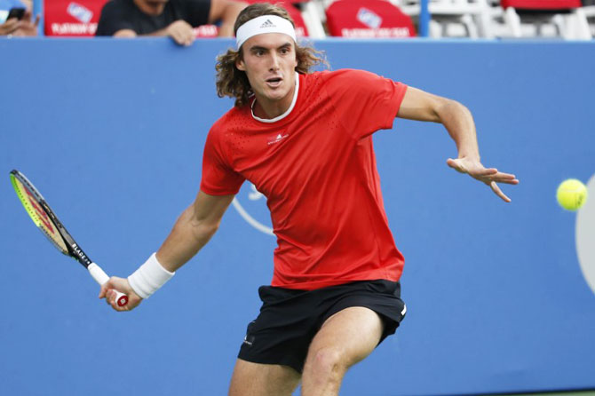 Stefanos Tsitsipas of Greece hits a forehand against Benoit Paire of France during their men's singles quarter-final of the 2019 Citi Open at William H.G. FitzGerald Tennis Center in Washington DC on Friday
