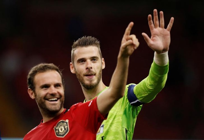 Manchester United's David De Gea and Juan Mata celebrate after victory over A C Milan in the International Champions Cup match