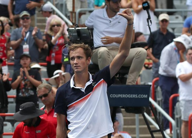 Daniil Medvedev of Russia waves to the crowd after defeating Dominic Thiem of Austria