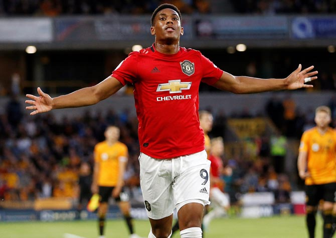 Anthony Martial celebrates scoring the goal for Manchester United during the match against Wolverhampton Wanderers on Monday