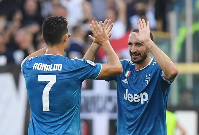 PHOTOS: Juventus win, Real Madrid held