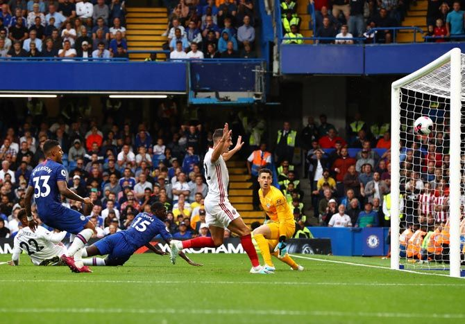 Kurt Zouma of Chelsea scores an own goal for Sheffield United's second goal