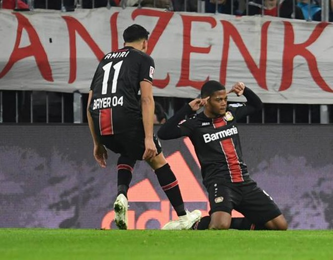 Leon Bailey celebrates scoring Bayer Leverkusen's first goal against Bayern Munich