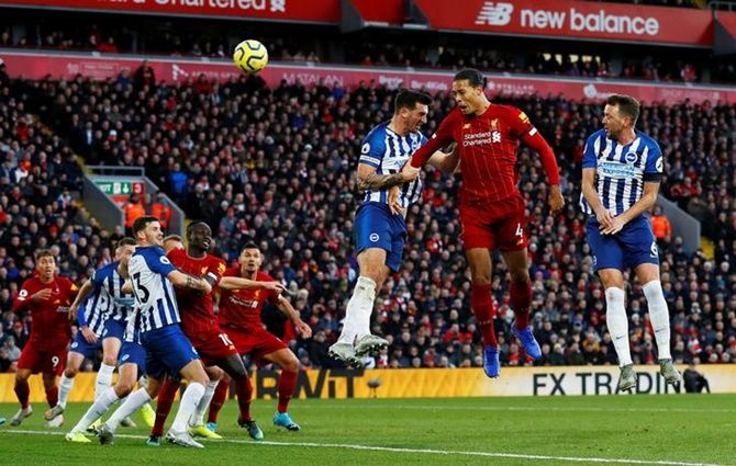 Virgil van Dijk scores Liverpool's second goal in Saturday's Premier League match against Brighton & Hove Albion
