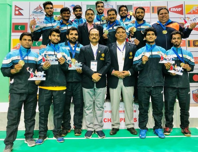 The Indian men's badminton team pose with their medals after beating Sri Lanka in the team final at the South Asian Games in Pokhara, Nepal, on Monday.