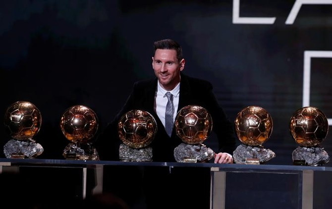 Lionel Messi with his six Ballon d'Or trophies.