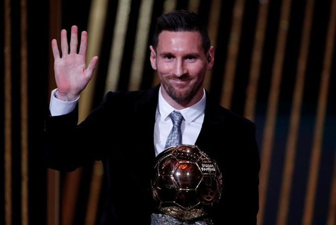 Barcelona's Lionel Messi waves to the crowd after receiving the the Ballon d'Or award at the Theatre du Chatelet, in Paris.