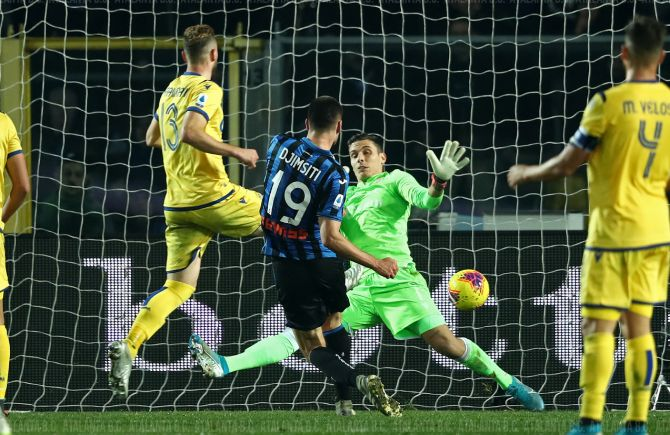 Atalanta's Berat Djimsiti scores past Verona's keeper Marco Silvestri to score the last minute winner in their Serie A match at Gewiss Stadium in Bergamo, Italy on Saturday