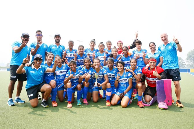 The Indian junior women's hockey team and support staff celebrate on winning the 3-nation tournament in Canberra, Australia, on Sunday