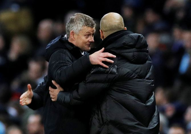Manchester City manager Pep Guardiola and Manchester United manager Ole Gunnar Solskjaer after the Manchester derby last month