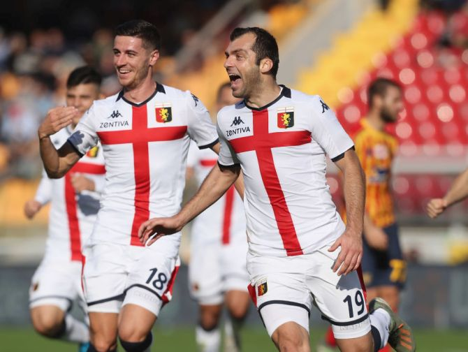 Genoa's Goran Pandev (right) celebrates after scoring his team's opening goal during their Serie A match against US Lecce at Stadio Via del Mare in Lecce, Italy, on Sunday