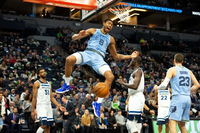 Memphis Grizzlies forward Bruno Caboclo (5) dunks the ball during the third quarter of their NBA match against the Minnesota Timberwolves at Target Center in Minneapolis, Minnesota, on Sunday, December 1.