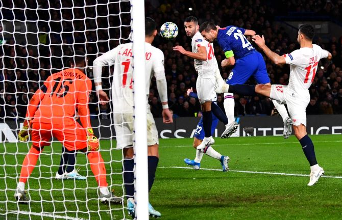 Chelsea's Cesar Azpilicueta heads to net their second goal against Lille during their Champions League Group H match at Stamford Bridge in London