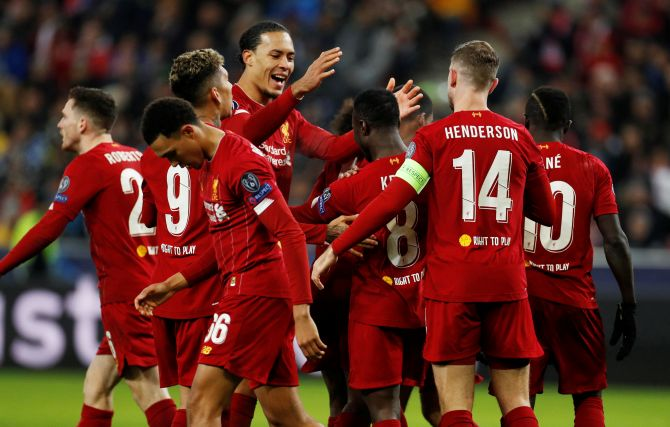 Liverpool's Naby Keita celebrates with Virgil van Dijk and teammates after scoring their first goal against FC Salzburg during their Champions League Group E match at Red Bull Arena Salzburg, Salzburg, Austria