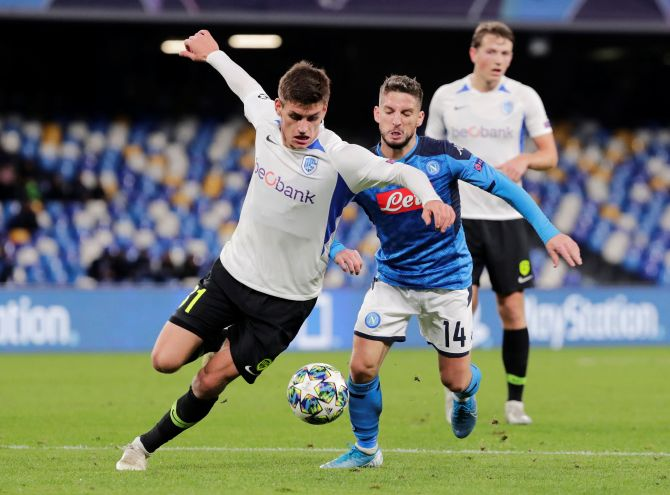 Napoli's Dries Mertens and KRC Genk's Joakim Maehle battle for possession during their Champions League Group E match at Stadio San Paolo in Naples, Italy