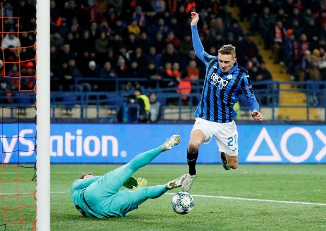Atalanta's Timothy Castagne scores their first goal which was awarded after a VAR review during their Champions League Group C match against Shakhtar Donetsk at Metalist Stadium in Kharkiv, Ukraine