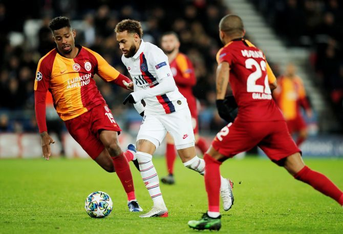 Paris St Germain's Neymar beats Galatasaray's Ryan Donk to the ball during their Champions League Group A match at Parc des Princes in Paris, France