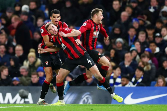 AFC Bournemouth's Dan Gosling celebrates with teammates Dominic Solanke and Ryan Fraser after scoring against Chelsea at Stamford Bridge in London