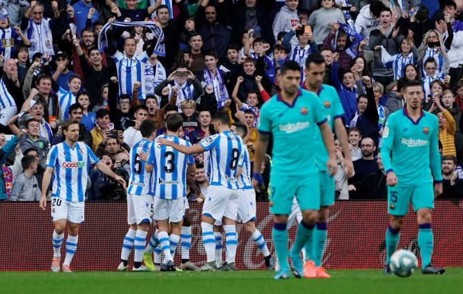 Real Sociedad's Mikel Oyarzabal celebrates  with teammates after scoring their opening goal