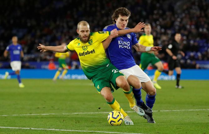 Norwich City's Teemu Pukki vies with Leicester City's Caglar Soyuncu