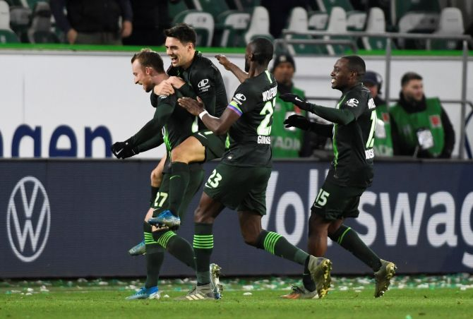 VfL Wolfsburg's Maximilian Arnold celebrates with teammates on scoring their second goal against Borussia Moenchengladbach during their Bundesliga match at Volkswagen Arena in Wolfsburg