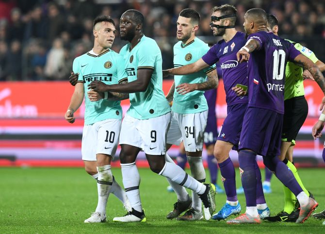 Inter Milan's Lautaro Martinez clashes with Fiorentina's Kevin-Prince Boateng during their Serie A match at Stadio Artemio Franchi in Florence
