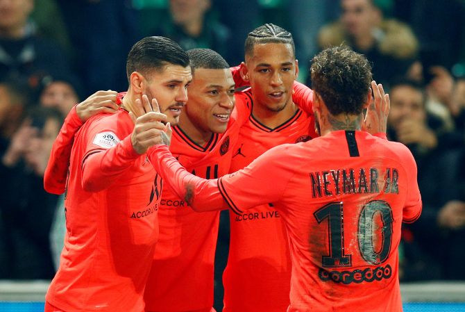 Paris St Germain's Kylian Mbappe celebrates scoring their fourth goal with Neymar and teammates after scoring against AS Saint-Etienne during their Ligue 1 match at Stade Geoffroy-Guichard, Saint-Etienne