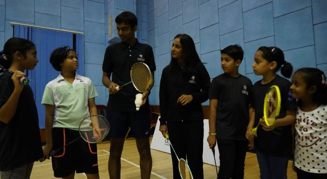 India's badminton coach Pulella Gopichand and former champion Aparna Popat at a badminton clinic for children during the official launch of the Badminton Gurukul at MCA Club in BKC, Mumbai on Thursday