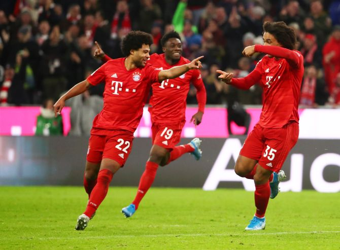 Bayern Munich's Serge Gnabry celebrates with teammates after scoring their second goal against VfL Wolfsburg at Allianz Arena in Munich on Saturday