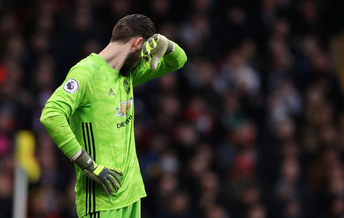 Manchester United's David de Gea reacts after a keeping error at Vicarage Road in Watford