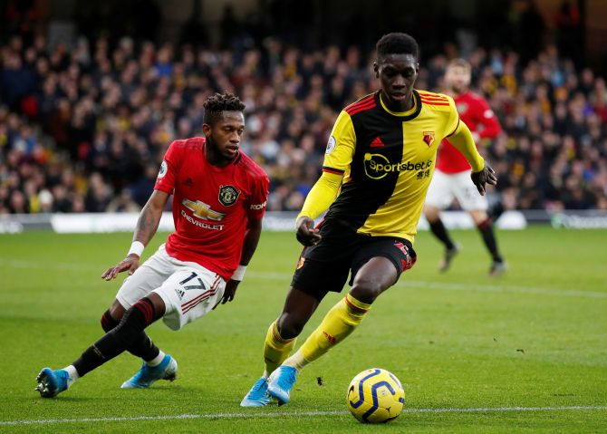 Watford's Ismaila Sarr and Manchester United's Fred vie for possession
