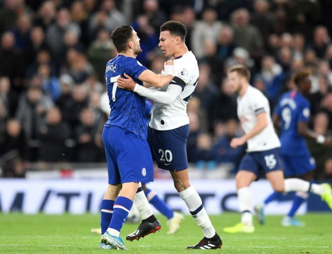 Chelsea's Mateo Kovacic clashes with Tottenham Hotspur's Dele Alli