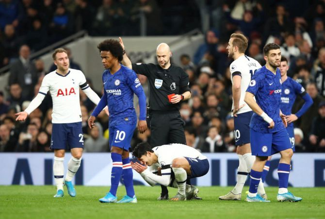 Tottenham Hotspur's Heung-Min Son is shown a red card by referee Anthony Taylor