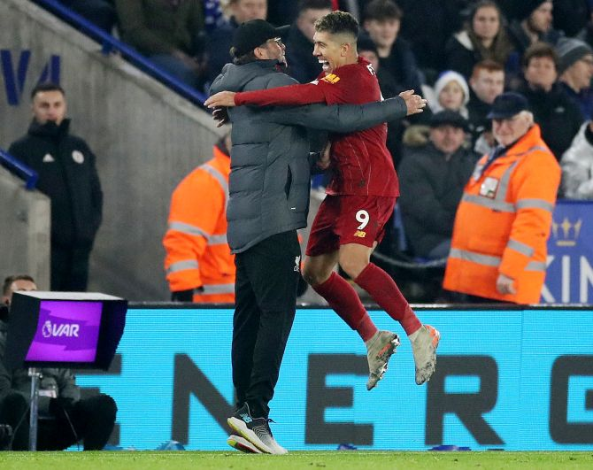 Liverpool's Roberto Firmino celebrates with manager Juergen Klopp (Image used for representative purposes)