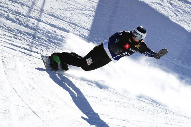 Czech Republic's Vendula Hopjakova competes during the Ladies' Snowboard Cross Qualifier on Thursday