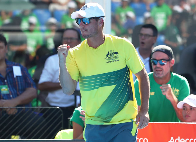 Australia captain Lleyton Hewitt celebrates as John Millman of Australia wins the first set during his rubber 1 singles match against Damir Dzumhur of Bosnia / Herzegovina on Friday. 'Lleyton is right to say Bernard will not be considered for Davis Cup. Bernard does not meet the standards of behaviour and commitment to himself, the team or the sport'