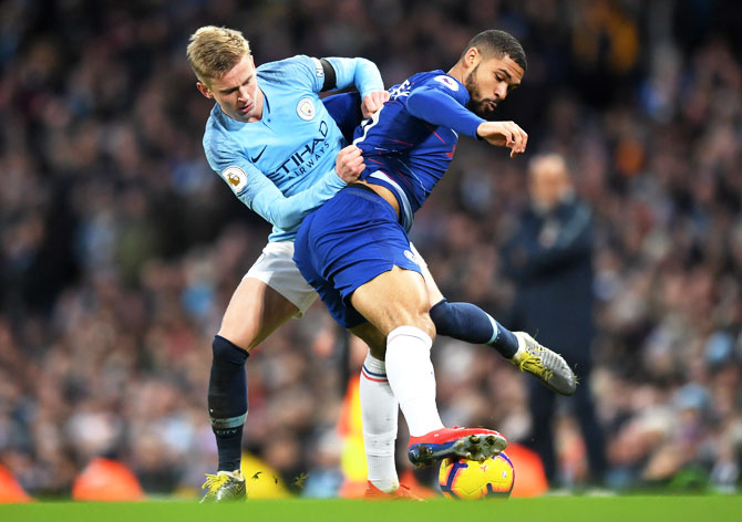 Chelsea's Ruben Loftus-Cheek is challenged by Manchester City's Oleksandr Zinchenko