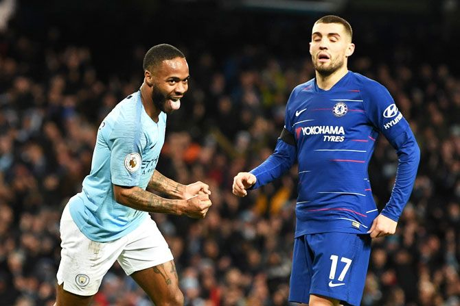 Manchester City's Raheem Sterling celebrates after scoring his team's sixth goal as Chelsea's Mateo Kovacic looks dejected during their EPL game on Sunday