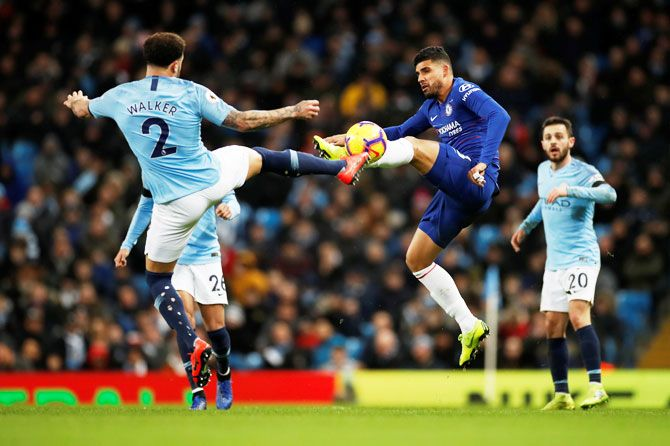 Manchester City's Kyle Walker and Chelsea's Emerson Palmieri vie for possession