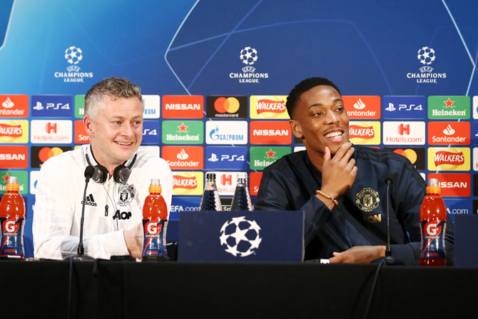 Manchester United's interim Manager Ole Gunnar Solskjaer and forward Anthony Martial at a press conference ahead of their UEFA Champions League Round of 16 match against Paris Saint-Germain at Aon Training Complex in Manchester, on Monday