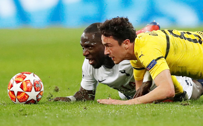 Borussia Dortmund's Thomas Delaney and Tottenham's Moussa Sissoko in action during their Champions League Round of 16 first leg match on Wednesday, February 13